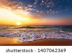 beautiful golden sunset over... | Shutterstock . vector #1407062369