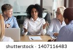 Small photo of African american businesswoman talking to clients make business offer explain deal benefit convince diverse partners at group negotiation meeting, mixed race manager consult customers sell services