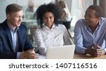 Small photo of Salesman broker insurer advisor consult work with african american clients family couple looking at laptop make business offer, manager mentor explain deal benefit convince customers instruct interns