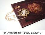 Small photo of Valencia, Spain - October 17, 2015: A photo of a Hermione's Time Turner over the Harry Potter photo album. Objects of the film Harry Potter.