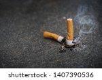 cigarette butt on black granite ... | Shutterstock . vector #1407390536
