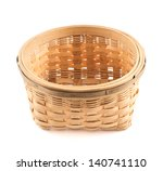 Wooden round wicker basket isolated over white background - stock photo
