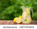 Lemonade In Glass Jug On Wooden ...
