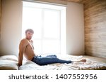 young shirtless sexy man on bed ... | Shutterstock . vector #1407552956
