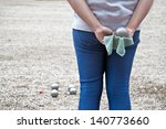 Woman with boule balls during a game - stock photo