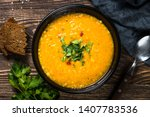 red lentil soup puree in black... | Shutterstock . vector #1407783536