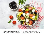 greek salad. vegetable salad... | Shutterstock . vector #1407849479