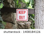 Small photo of Keep Out Sign on wooden post