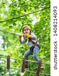 Small photo of Child boy having fun at adventure park. Go Ape Adventure. Cargo net climbing and hanging log. Early childhood development. Artworks depict games at eco resort which includes flying fox or spider net