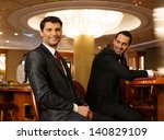 two young men in suits behind... | Shutterstock . vector #140829109
