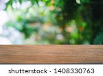 empty dark wooden table in... | Shutterstock . vector #1408330763
