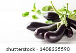 fresh eggplants on a white... | Shutterstock . vector #1408335590