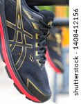 Small photo of Bangkok, Thailand - May 4, 2019 :ASICS Running Shoes GT-2000 7 shot outdoor, ASICS is a Japanese multinational corporation athletic equipment company which produces footwear and sports equipment.