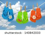 Colorful Flip Flops On A...