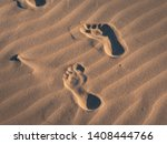 Footsteps In The Sand On A...