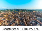 Florence, Tuscany / Italy - April 15th, 2019: General view of Florence as seen from the top of the Campanile of Giotto, with Palazzo Vecchio in the middle and Palazzo Pitti in the distance
