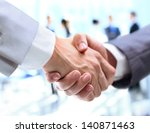 closeup of a business handshake | Shutterstock . vector #140871463