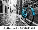 Retro Blue Bike On Old Town...