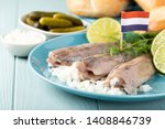 Stock photo traditional dutch food freshly salted herring fish with onion called hollandse nieuwe european 1408846739