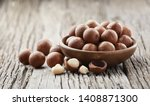 macadamia nuts on wooden... | Shutterstock . vector #1408871300