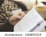 person holding a book in... | Shutterstock . vector #140895319