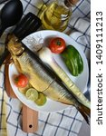 Stock photo mediterranean food smoked herring fish served with green onion lemon tomatoes green pepper olive 1409111213