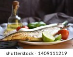 Stock photo mediterranean food smoked herring fish served with green onion lemon tomatoes green pepper olive 1409111219