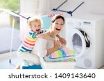 mother and kids in laundry room ... | Shutterstock . vector #1409143640