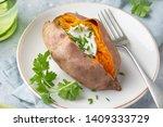 baked sweet potato with yogurt... | Shutterstock . vector #1409333729