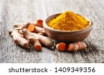 turmeric root and powder on... | Shutterstock . vector #1409349356