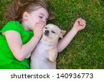 Stock photo blond happy girl with her chihuahua doggy portrait lying on lawn 140936773