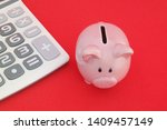 piggy bank and calculator on... | Shutterstock . vector #1409457149