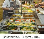 Stock photo cuisine cafeteria buffet with food self service food display showcase 1409534063