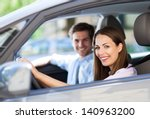young couple sitting in car | Shutterstock . vector #140963200