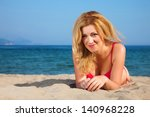 attractive woman on a seacoast | Shutterstock . vector #140968228