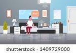 man sitting on bed using... | Shutterstock .eps vector #1409729000