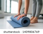 yoga at home woman rolling... | Shutterstock . vector #1409806769
