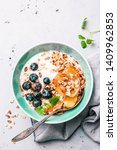 healthy breakfast or dessert.... | Shutterstock . vector #1409962853