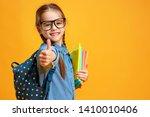 funny child school girl girl on ... | Shutterstock . vector #1410010406