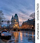 Frozen Canal In Amsterdam With...