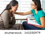 woman having counselling session | Shutterstock . vector #141030979