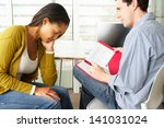 woman having counselling session | Shutterstock . vector #141031024