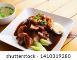 duck and crispy pork over rice...   Shutterstock . vector #1410319280