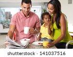 family having breakfast in...   Shutterstock . vector #141037516