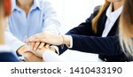 business team showing unity... | Shutterstock . vector #1410433190