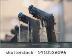 guns on a show window of shop.... | Shutterstock . vector #1410536096