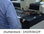 worker in the industrial laser... | Shutterstock . vector #1410536129