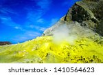 Mountain crater volcano view landscape. Mountain volcano crater yellow fog. Yellow fog in mountain volcano crater. Mointan fog