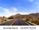 empty dessert road with... | Shutterstock . vector #1410572210