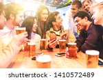 happy millennial friends at pub ... | Shutterstock . vector #1410572489